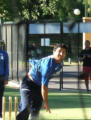 Piyush Chawla of India, bowling a leg break.