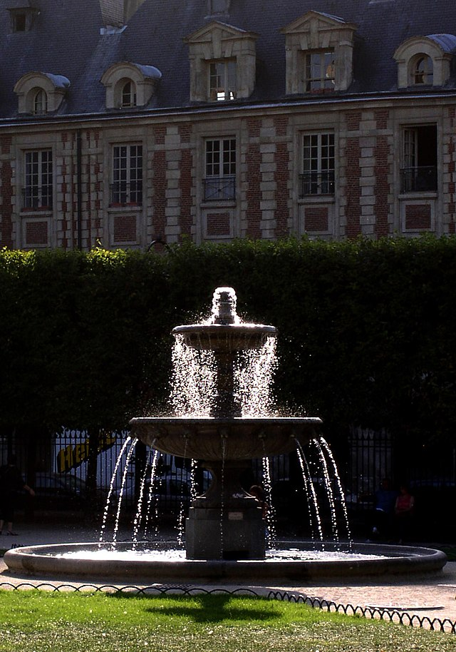 Haute Travel - Le Marais Paris France {fountain near Place des Vosges}