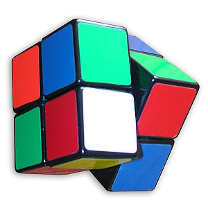 Pocket Cube - Pocket Cube in different forms. From top (to bottom): i. Solved pocket cube. ii. Scrambled pocket cube. iii.Pocket cube with one side tilted.