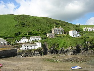 """Port Isaac - View of Doc Martin's fictional home, which is actually """"Fern Cottage"""" shown in the centre of the picture"""