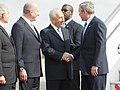President George W. Bush is greeted by Israel's President Shimon Peres, center, and Prime Minister Ehud Olmert.jpg