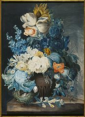 A group of flowers in a jar and a bird's nest