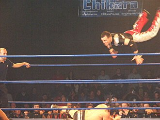 Mike Quackenbush - Quackenbush going for a high-angle senton bomb on the Great Sasuke