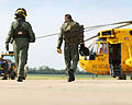 RAF Aircrew Walking to Sea King Helicopter at Wattisham Airfield MOD 45158475.jpg