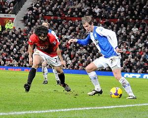 Rafael (footballer, born 1990) - Rafael defending against Morten Gamst Pedersen of Blackburn Rovers