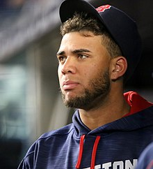 Red Sox prospect Yoan Moncada looks on from the dugout. (29997392685).jpg