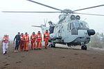 Rescued crew members of MV Coastal Pride after landing at Umargaon beach.jpg