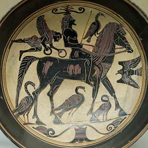 Augury - A confident rider, surrounded by birds of good omen is approached by a Nike bearing victor's wreaths on this Laconian black-figured kylix, ca. 550–530 BC
