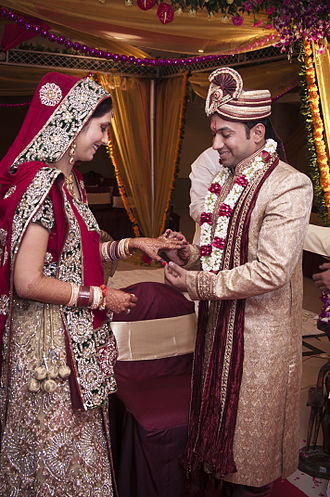 Culture of India - Bride in Sari and Groom in Sherwani in a Hindu Indian wedding.