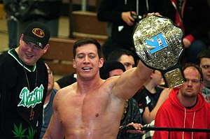 Egotistico Fantastico - Anthony with the RPW Heavyweight Championship belt in February 2013.