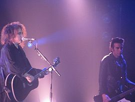 Robert Smith (left) and Simon Gallup (right) playing as The Cure on June 21, 2008 at Radio City Music Hall in New York City