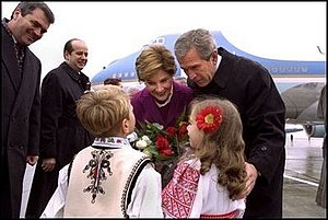 Laura Bush - Romanian children greet President and Mrs. Bush upon their landing in Bucharest, 2002