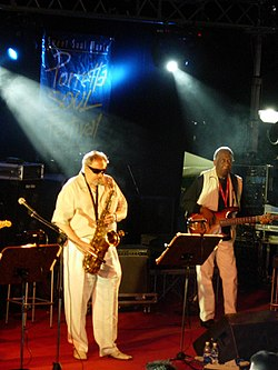 Ronnie Cuber (playing tenor sax) and Chuck Rainey performing at the Porretta Soul Festival in 2005.