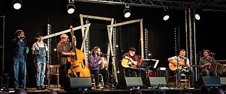 Roy Bailey (folk singer) - Performing his final Monday afternoon concert at Towersey Festival 2018, with a band including Martin Simpson, Andy Cutting, Marc Block, Kit Simpson and Max Simpson