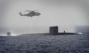 Royal Navy Submarine HMS Turbulent with a Merlin Helicopter from HMS St Albans MOD 45153520.jpg