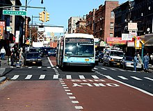 Offset, red-painted bus lane on Nostrand Avenue in Brooklyn