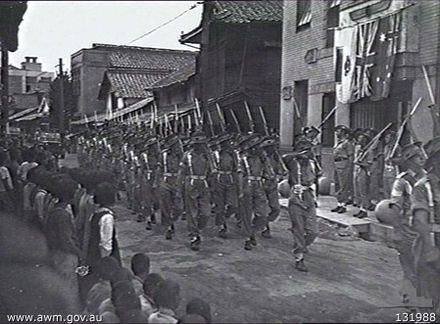 Troops from the 66th Battalion march through Saijo, Japan in 1946 Saijo (AWM 131988).jpg