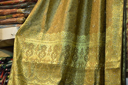A traditional Banarasi sari with gold brocade Saree on display at Dilli Haat.JPG