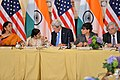 Secretary Kerry Chats With Indian External Affairs Minister Swaraj at the U.S.-India Joint Strategic and Commercial Dialogue Opening Plenary (21442237629).jpg