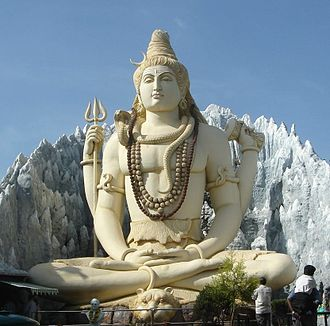 Yoga - Statue of Shiva in Bangalore, Karnataka, India, performing yogic meditation in the Padmasana posture.