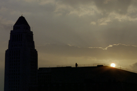 The silhouette of City Hall at sunrise.