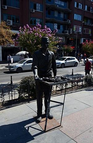 Simit - Statue of simit (bagel) seller in Çorlu, Tekirdağ, Turkey.