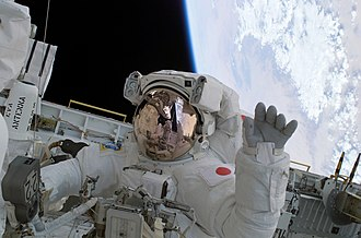 Soichi Noguchi - During the mission's second spacewalk STS-114 astronaut Soichi Noguchi waves from the Shuttle payload bay.
