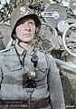 Soldier of a coastal artillery crew. Behind him is their gun, a 120 mm 50 caliber Pattern 1905. On the Valamo (Valaam) archipelago in Lake Ladoga, Karelia, 11 July 1942. (46979106112).jpg