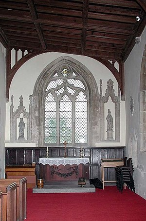 Merton, Oxfordshire - St Swithun's parish church: chapel in the south aisle, with 14th century Decorated Gothic east window
