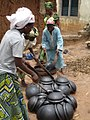 Stacking of already finished black pots with sticks by Ilorin potters.jpg
