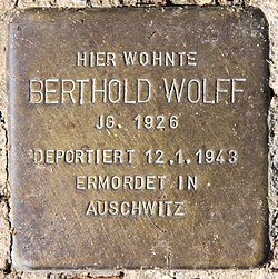 Photo of Berthold Wolff brass plaque