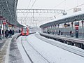 Streshnevo platform with arriving ES2G train.jpg