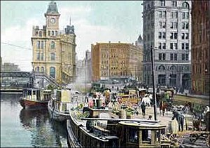 Clinton Square - Erie Canal packet dock in 1890 - Clinton Square in Syracuse, New York at that time part of the Bastable Block predecessor to the State Tower Building - Gridley Building on left - The new Onondaga County Savings Bank is the tall building on the right