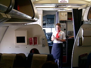 Picture of a TAM Flight Attendant working.