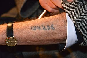 Identification in Nazi camps - A Holocaust survivor displaying his arm tattoo.
