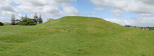 Taylors Hill - Scoria cone of Taylors Hill with Māori kumara pits in left foreground.