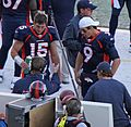 Tebow and Quinn on the Sidelines (6523392677).jpg