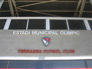 Terrassa Futbol Club logo on stadium wall.jpg
