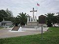 Terre-Aux-Boeufs Cemetery Mch 2012 Vets Crucifix Plaque.JPG