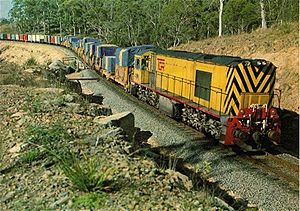 Tasmanian Government Railways - Za class locomotive, hauling a train through Bell Bay, Tasmania.
