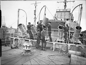 HMS Whitehall - The unsuccessful Thornycroft five-barreled long-range depth charge projector during trials in July 1941 installed on the forecastle of HMS Whitehall.