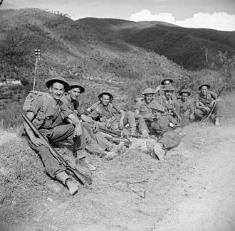 4th Infantry Division (United Kingdom) - Men of the Royal West Kents (possibly the 1st Battalion) rest by the roadside in mountainous terrain, 1 August 1944.