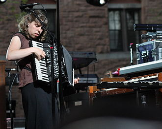 The Decemberists - Conlee playing accordion, with other keyboard instruments nearby