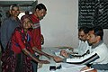 The Electoral Officer applying indelible ink on a old woman voter at a polling booth in Gujarat Assembly Election-2007, in Saurashtra on December 11, 2007.jpg