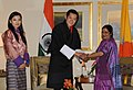 The Leader of Opposition in Lok Sabha, Smt. Sushma Swaraj with the King of Bhutan, His Majesty Jigme Khesar Namgyel Wangchuck and the Bhutan Queen, Her Majesty Jetsun Pema Wangchuck, in New Delhi on January 25, 2013.jpg
