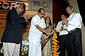 """The Minister of State (Independent Charge) for Consumer Affairs, Food and Public Distribution, Professor K.V. Thomas lighting the lamp to inaugurate the Seminar, """"Less waste.jpg"""