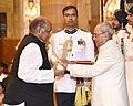 The President, Shri Pranab Mukherjee presenting the Padma Vibhushan Award to Shri Sharadchandra Govindrao Pawar, at a Civil Investiture Ceremony, at Rashtrapati Bhavan, in New Delhi on March 30, 2017.jpg