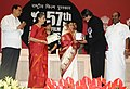 The President, Smt. Pratibha Devisingh Patil presenting the Rajat Kamal Award to Shri Amitabh Bachchan for Best Actor (Film Paa), at the 57th National Film Awards function, in New Delhi on October 22, 2010.jpg