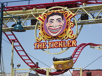 "Luna Park, Coney Island (2010) - The Tickler ride with the Coney Island ""Funny Face"" logo."