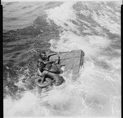 The U.S.S. Queenfish rescuing British and Australian prisoners of war, survivors of the Japanese ship Rakuyo Maru... - NARA - 520654